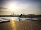 Man Diving into Rooftop Pool, Barcelona, Catalonia, Spain, Europe Photographic Print by  Purcell-Holmes