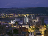 Floodlit Conwy Castle, Overlooking the Town with the River Conwy Estuary Beyond at Dusk, Gwynedd Photographic Print by Nigel Blythe