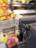 Man on Bike at Tet Festival, Ho Chi Minh City, Vietnam, Indochina Photographic Print by  Purcell-Holmes