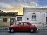 Classic Red American Car Parked Outside Houses at Sunset, Cienfuegos Photographic Print by Lee Frost