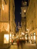 Christmas Decorations at Getreidgasse During Twilight, Salzburg, Austria, Europe Photographic Print by Richard Nebesky