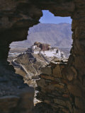 Potala Palace, Seen Through Ruined Fort Window, Lhasa, Tibet Photographic Print by Nigel Blythe