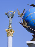 Statue of a Blue Globe with Doves of Peace and Symbol of Kiev Statue Photographic Print by Christian Kober