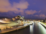 The Guggenheim, Designed by Canadian-American Architect Frank Gehry, on the Nervion River Photographic Print by Christian Kober