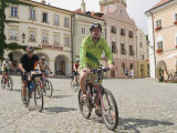 Cyclists Riding Through Namesti in Town of Mikulov, Brnensko Region Photographic Print by Richard Nebesky