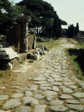 Via Ostiensa with Roman gate, Ostia, Italy Photographic Print