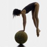 Woman Balancing on Globe Fotodruck von Alfonse Pagano