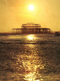 Sun over Ruin of West Pier, Brighton, Sussex, England Photographic Print by Neil Overy