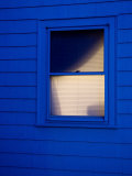 Window with Light On Photographic Print by John Nordell