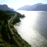 Freight Train Traveling Along Columbia River, Columbia River Gorge, Oregon, USA Photographic Print by Deon Reynolds