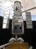 The Hubble Space Telescope Is Released from the Cargo Bay of Space Shuttle Atlantis Photographic Print