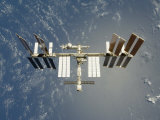 International Space Station Backdropped Against Earth Photographic Print