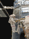 Astronauts Working on the Hubble Space Telescope During a Spacewalk Photographic Print