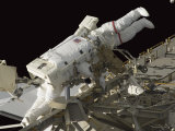 Astronauts Work on the International Space Station During a Spacewalk Photographic Print