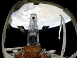 The Hubble Space Telescope, Locked Down in the Cargo Bay of Space Shuttle Atlantis Photographic Print