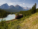 Freight Train Travelling on Morant&#39;s Curve Through Banff National Park, Alberta, Canada Photographic Print