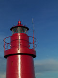 A Red Lighthouse with Blue Sky Photographic Print by Abdul Kadir Audah