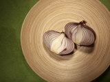 A Two One-Halfs of a Red Onion on a Wooden Plate Photographic Print by Tina Chang