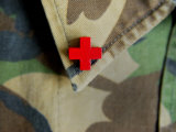 Red Cross on the Collar of a Camouflage Jacket Photographic Print by Winfred Evers
