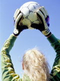 View from Behind of a Girl Holding a Soccer Ball Photographic Print by Steve Cicero