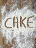 Word Cake in Flour Photographic Print by Neil Overy