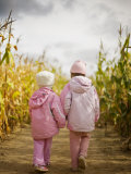 Two Children in Pink, Walking Through Cornfield Photographic Print by Elise Donoghue