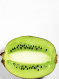 Half of Kiwi Fruit on White Background Photographic Print by Tina Chang