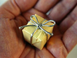 Tiny Present in a Mans Palm Photographic Print by Winfred Evers
