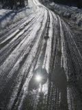 Muddy Wet Road Reflecting the Sunlight Photographic Print by John Churchman
