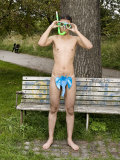 Young Man with Mask, Goggles, and Snorkles, Christiania, Copenhagen, Denmark Photographic Print by Rune Johansen
