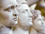 Close-Up of Statue Faces on a Shelf in the Vatican, Rome, Italy Photographic Print by Andrea Sperling
