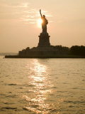 Sun Setting Behind the Statue of Liberty on a Summer Evening Photographic Print by John Nordell