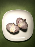 A Two One-Halfs of a Red Onion on a White Plate Photographic Print by Tina Chang