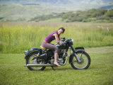 Young Woman Seated on an Antique Motorcycle Photographic Print by Pete McBride