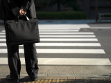 Businessman in a Dark Suit with Briefcase at a Crosswalk Photographic Print by  xPacifica
