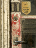 Door and Peeling Paint of Historic Building Photographic Print by Bill Hatcher