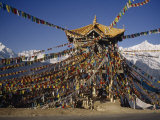Prayer Flags Hang on a Pagoda with Mei Li Holy Mountain in the Rear Photographic Print by  xPacifica