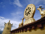 Prayer Wheel, Deer and Wheel of Dharma on the Roof of the Jokhang Photographic Print by  xPacifica