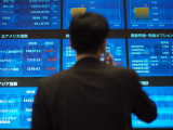Stock Quotes on Screens at the Tokyo Stock Exchange Photographic Print by  xPacifica
