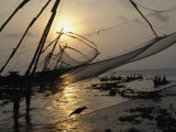 Chinese Style Fishing Nets Dip into the Arabian Sea Photographic Print by Michael S. Yamashita