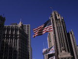 American Flag Near the Wrigley Building and Tribune Building Photographic Print by Paul Damien