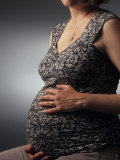 Nine Month Pregnant Woman Holds Her Belly Reproduction photographique par Paul Damien