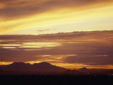 Sun Sets Behind Mountains in Arizona Photographic Print by  xPacifica