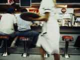 Waitress with a Tray Hurries Past in a Nw Washington, Dc Diner Photographic Print by Scott Sroka