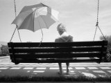 Woman with Alzheimer's Sits on a Swing Shaded by an Umbrella Photographic Print by Lynn Johnson