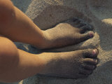 Child's Feet Covered in Sand Ridden with Black Oil Photographic Print by Stacy Gold