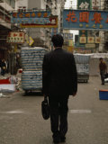 Office Worker with a Briefcase Walks Down a Kowloon Street Photographic Print by  xPacifica