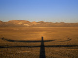 Shadow of a Tower Used to Monitor Nuclear Tests in the Sedan Crater Photographic Print by Lynn Johnson