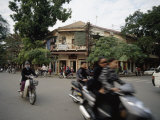People Ride Motorcycles Through the Streets of Hanoi, Vietnam Photographic Print by  xPacifica