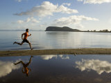 Man Running by the Water of Stump Bay Photographic Print by Dawn Kish
